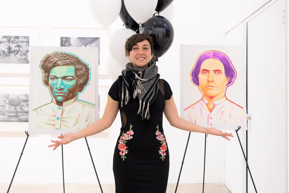 artist Alivia Ruiz standing between two portraits