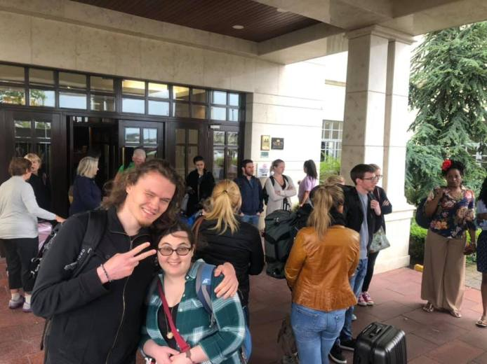 A picture of my girlfriend and I, in front of the hotel 30 minutes outside of Dublin where we had to spend the first night of our unexpected layover, taken by someone else in a similar situation that we met along the way.