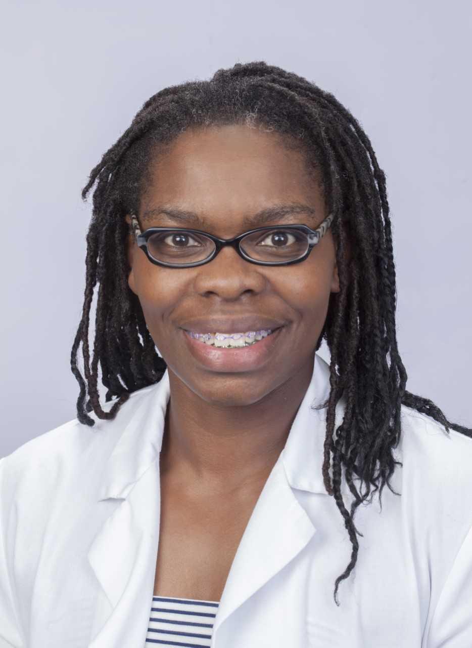 black american nurse in white coate
