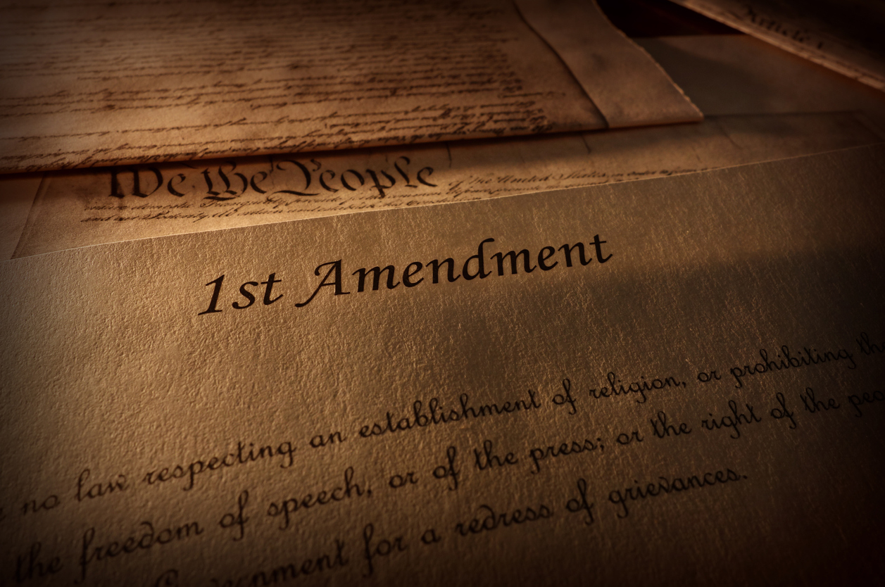 First Amendment of the US Constitution text, with other Constitution text above